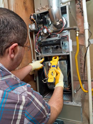What does a HVAC Repairman do during Heating Unit Maintenance